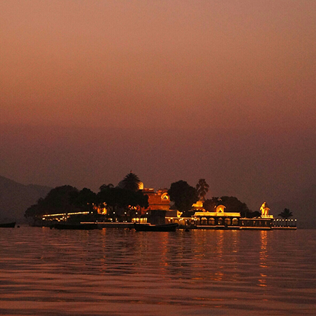 Sunset over Jagmandir Island Restaurant Hotel Island Udaipur City of Lakes Sunset Cruise