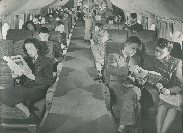 Pan-Am Airplane B377 Travelling in the 60s Cabin