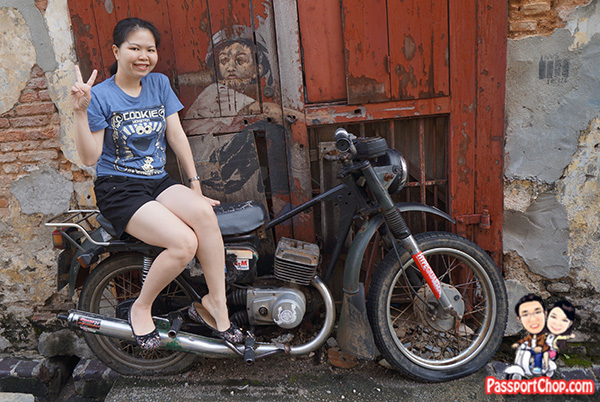 boy on motorcycle penang street art zacharevic