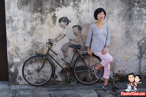 boy and girl on bicycle penang street art
