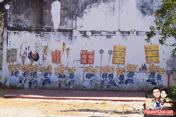cat and human living in harmony penang street art