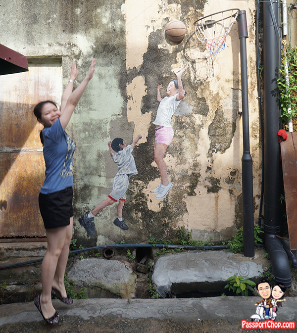 children playing basketball lebuh chulia penang street art